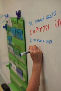 "Writing sentences with 'er"" words."